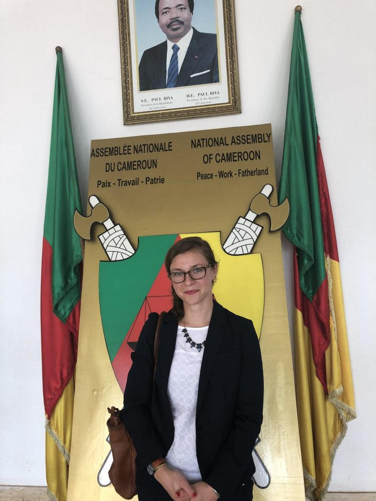 SIT alumna Sasha Lansky in front of flags and symbols at the National Assembly of in Cameroon