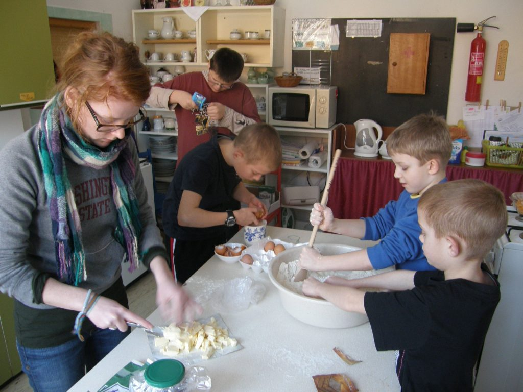 Teens and young students bake together