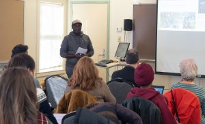 Kenneth Mukonyezi presents his research at the December 2018 Capstone Seminar.