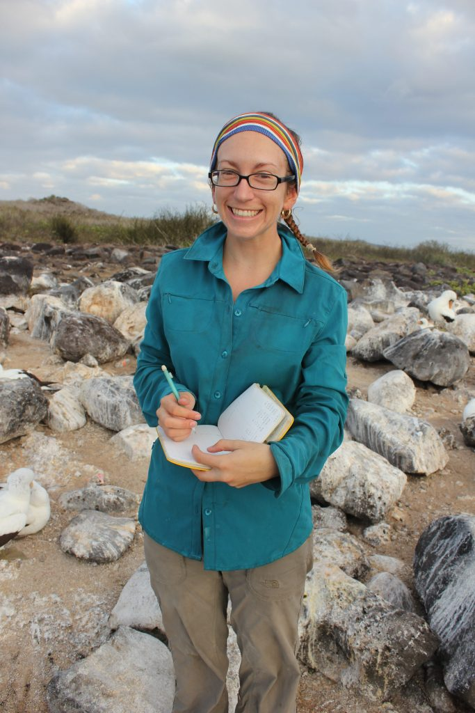 Jenny Howard writing in her notebook in the Galapagos