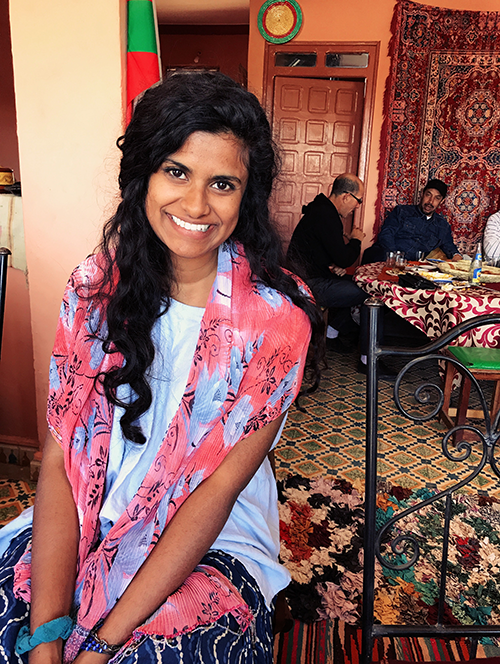 Young woman with floral scarf in a Moroccan home