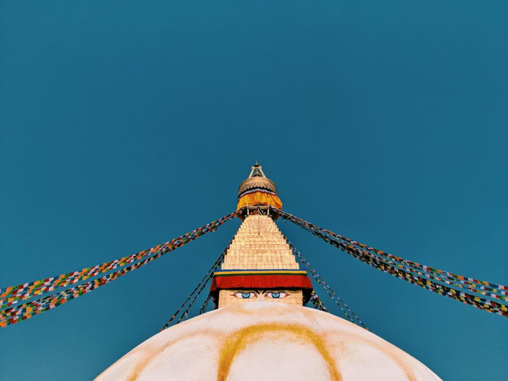 Boudhanath Stupa -- a dome with crown and prayer flags