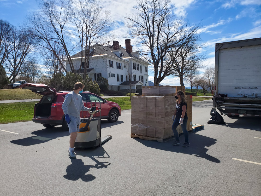 The Vermont Foodbank distributes boxes of food during an event on campus in April 2021.